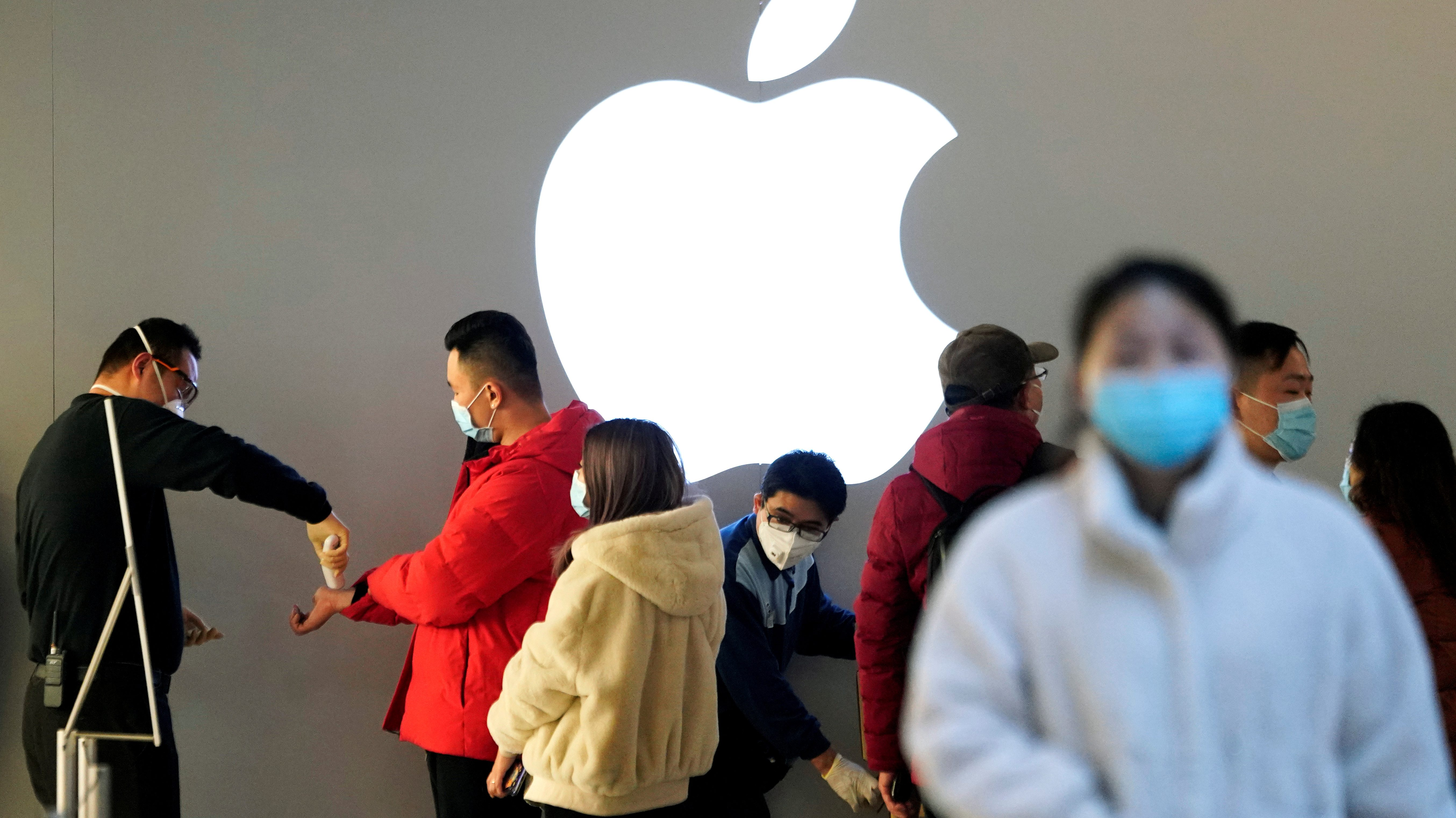 People wearing protective masks at an Apple Store in Shanghai