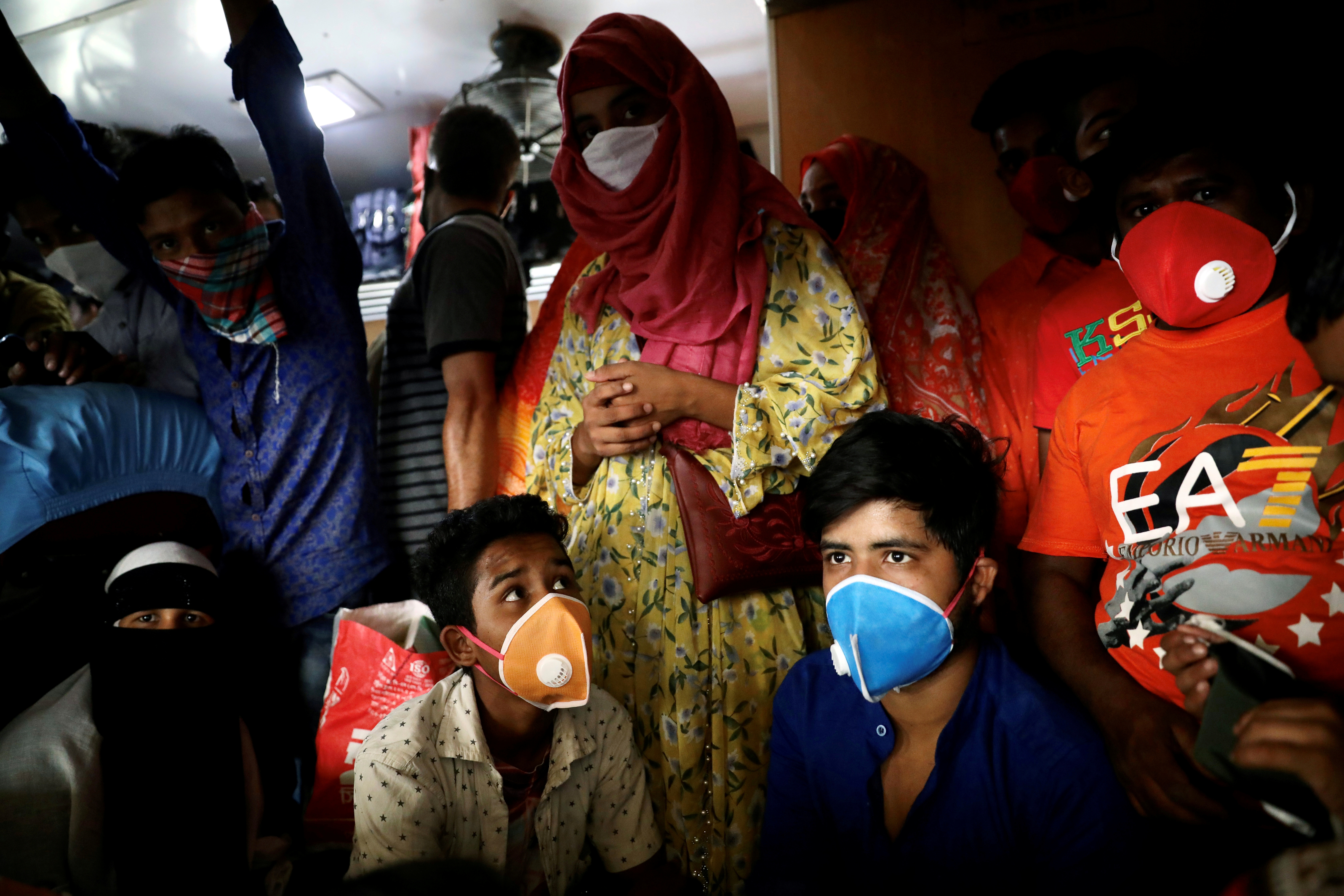 Migrant workers exit Dhaka by train on March 24, the day before Hasina's announcement.