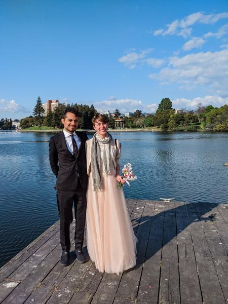 A photo taken of the couple by the lake.