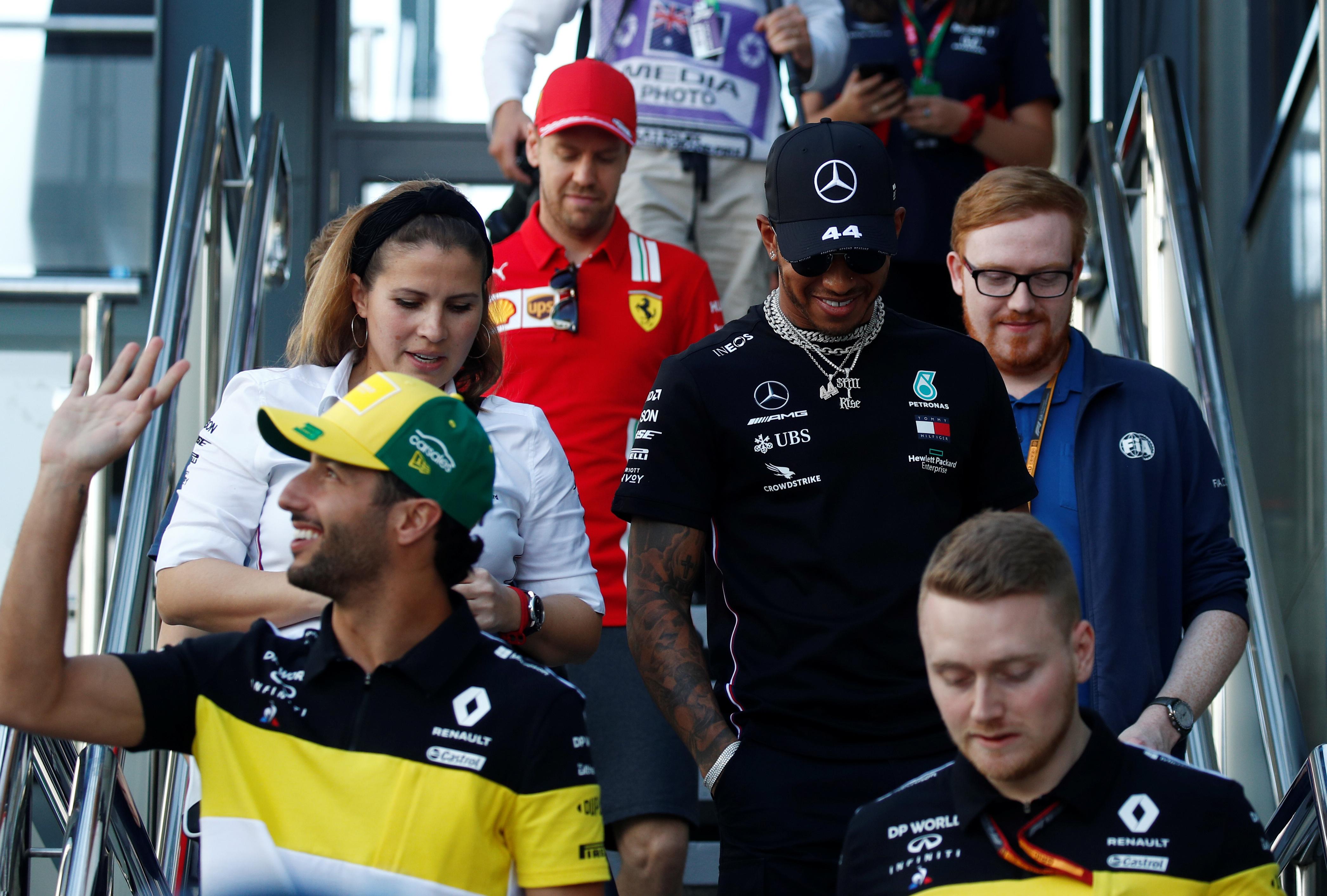 Formula One F1 - Australian Grand Prix - Melbourne Grand Prix Circuit, Melbourne, Australia - March 12, 2020 Mercedes' Lewis Hamilton, Renault's Daniel Ricciardo and Ferrari's Sebastian Vettel after the press conference
