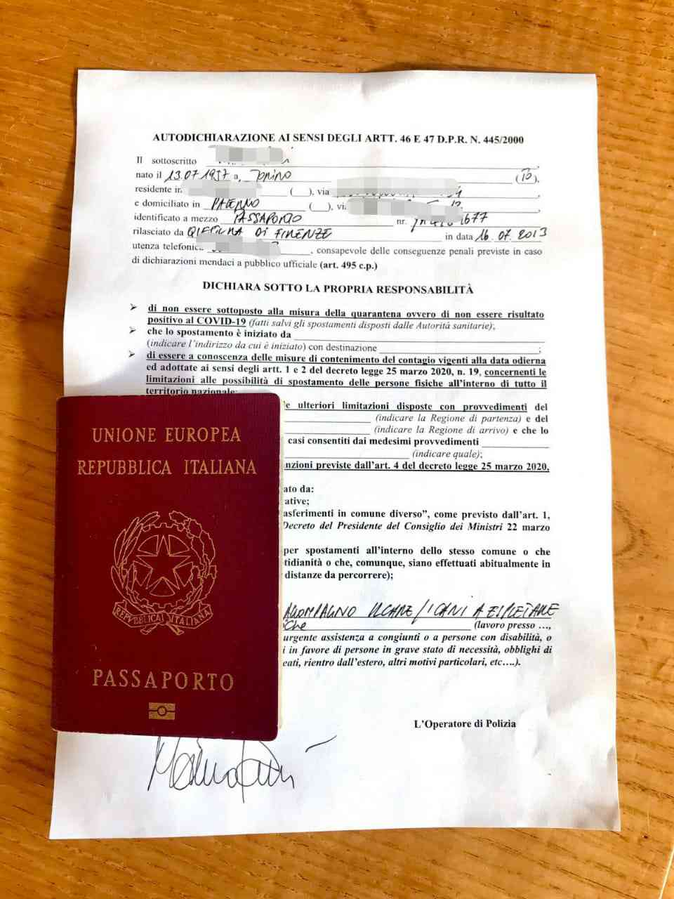 An image of a pass that allows Italians to move about, depending on need. The passport along with the pass is this person's identity document.