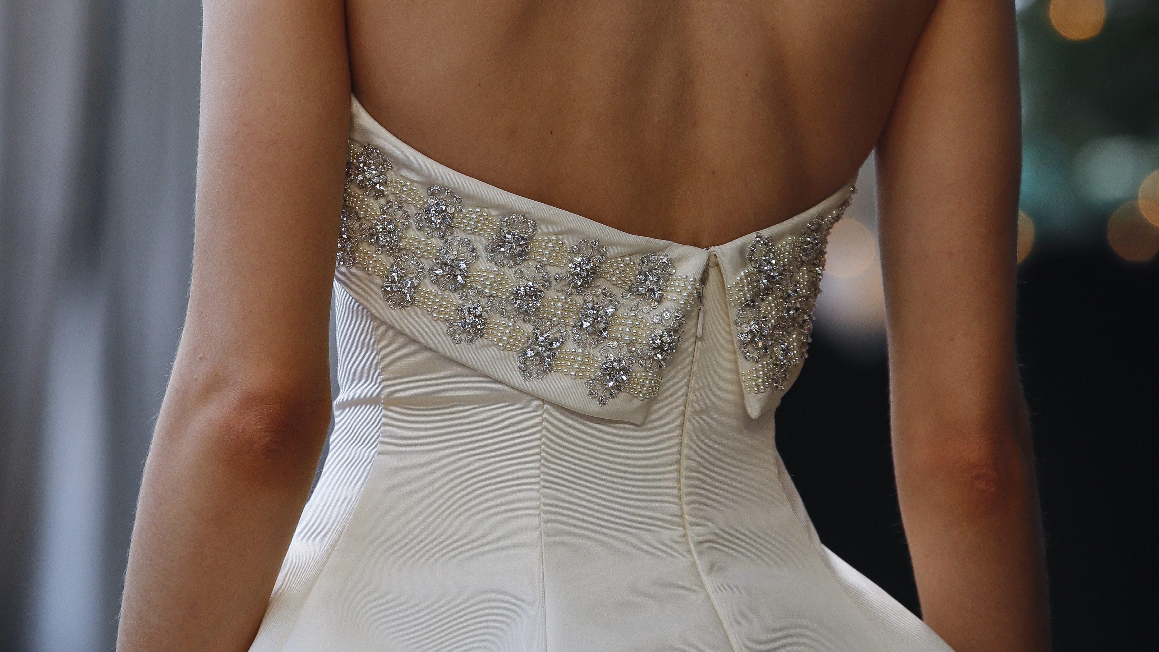 A woman models a wedding dress