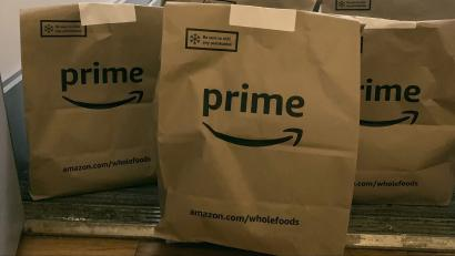 A delivery of groceries from Whole Foods is dropped at a customer's apartment door by Amazon Prime during the coronavirus pandemic