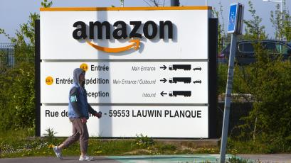 A man walks at the entrance of Amazon, in Douai, northern France