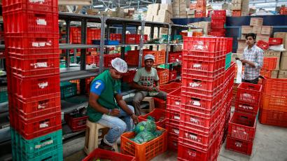 Workers at a BigBasket warehouse.