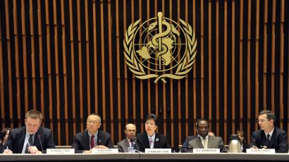 Representatives of WHO speak at a news conference