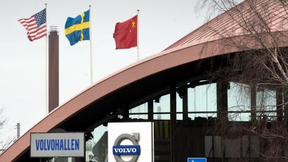 The flags of China, Sweden and the United States wave outside the Volvo Hall at the Volvo plant and headquarters in Torslanda, Gothenburg