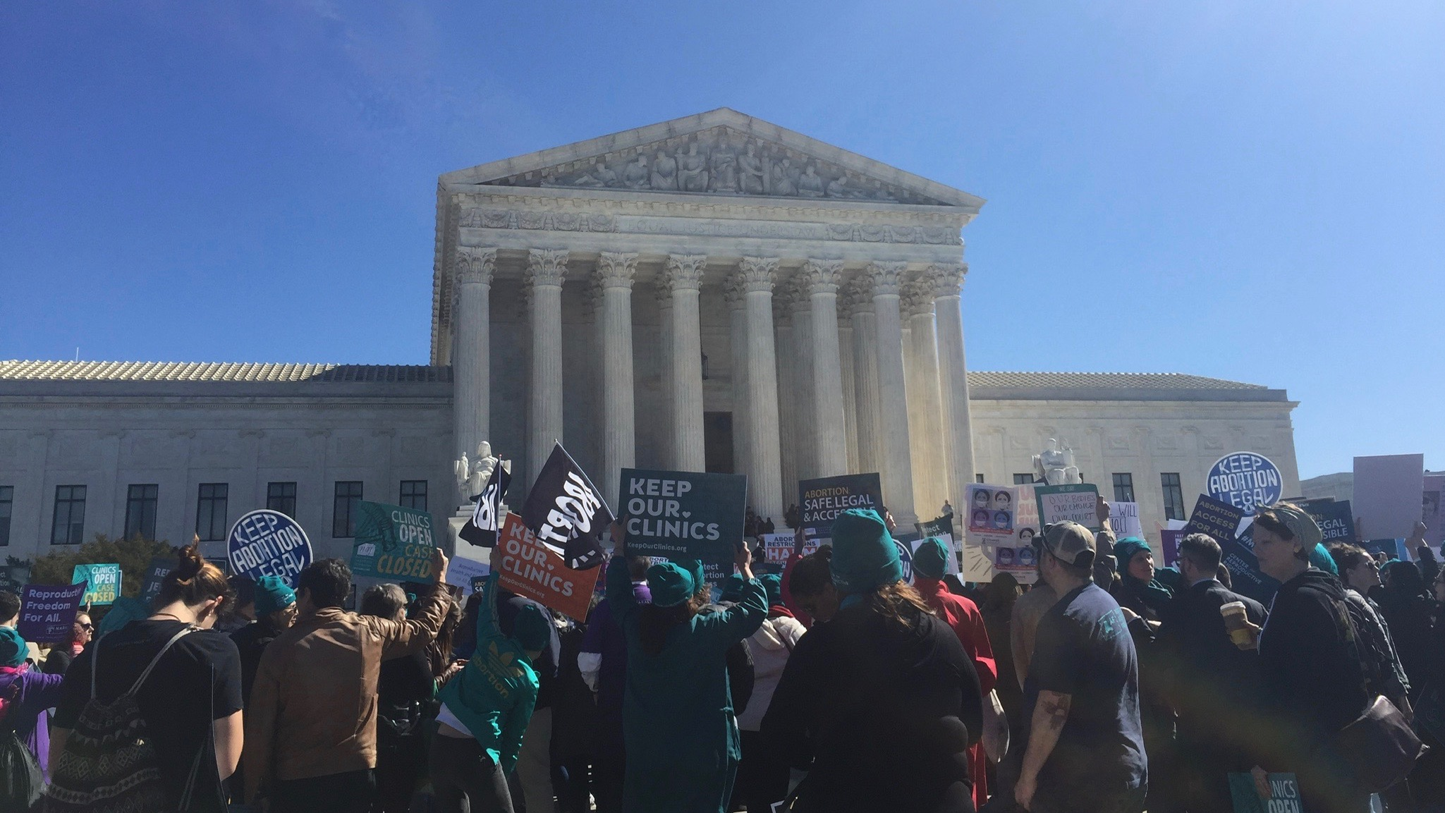 Activists in from top SCOTUS on March 4.