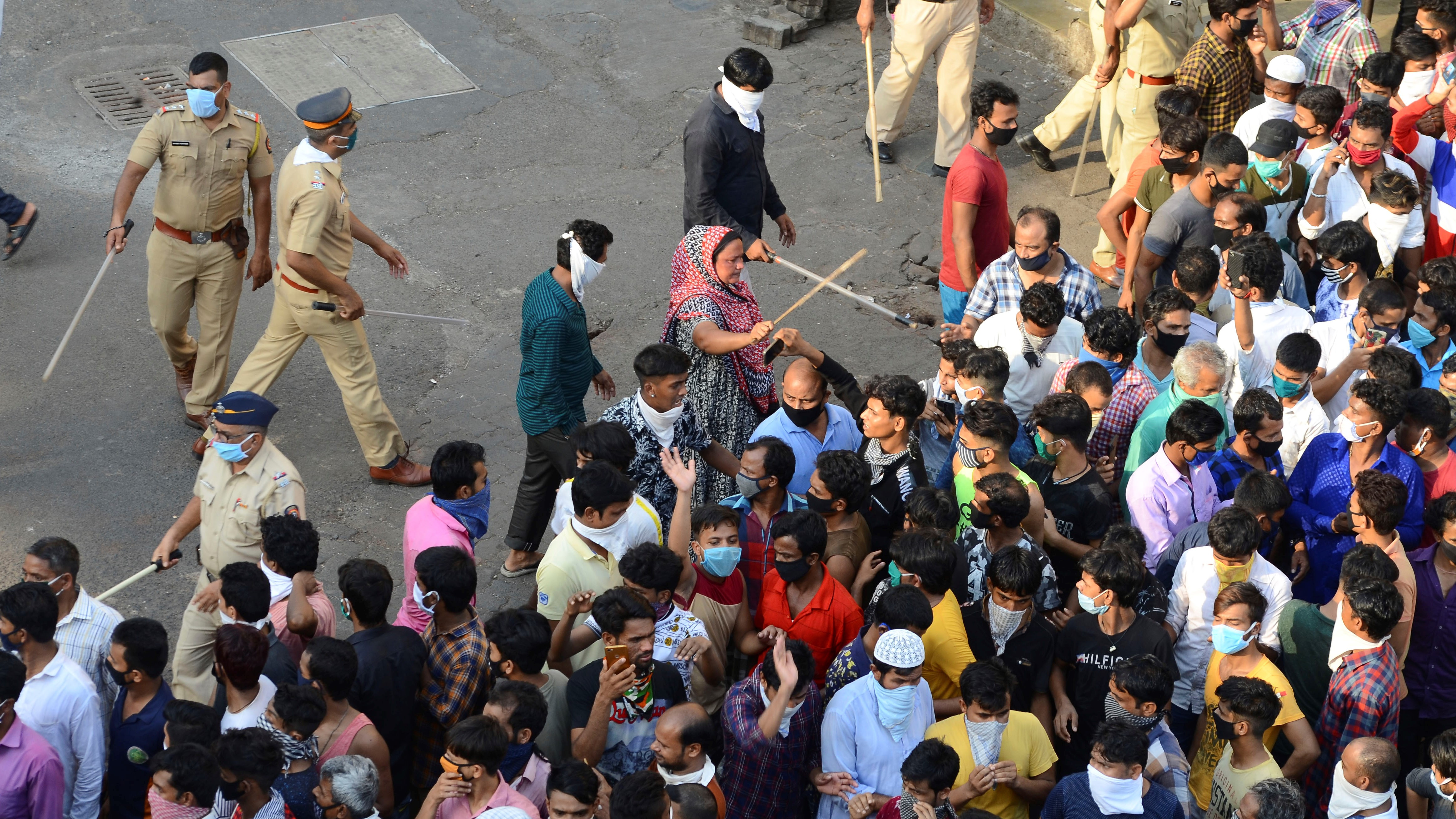Police cracks down on protesting migrants in Mumbai.