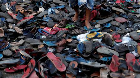Footwear of migrant protesters chased away by Mumbai Police.