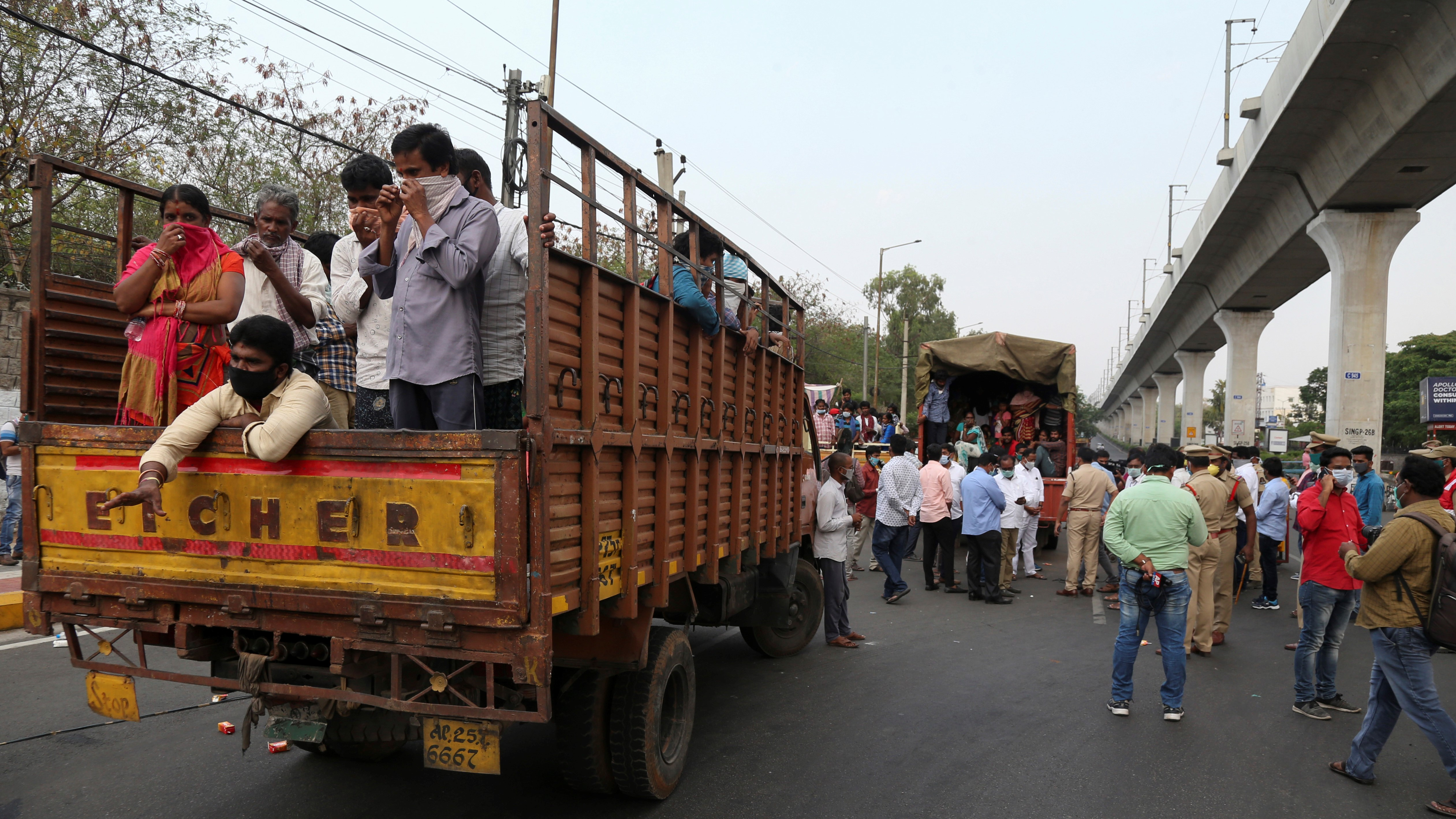 Migrants in Andhra Pradesh being moved to shelter homes.