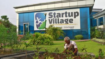 A gardener plants seedlings at the entrance of Start-up Village in Kinfra High Tech Park in Kochi