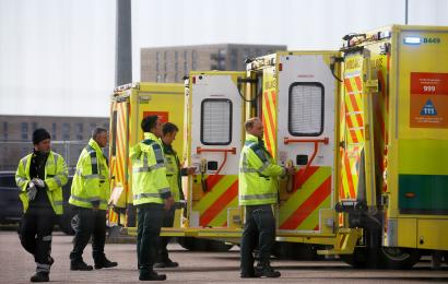 Paramedics and ambulances are seen outside the Excel Centre, London while it is being prepared to become the NHS Nightingale Hospital, as the spread of the coronavirus disease (COVID-19) continues, London, Britain, April 1, 2020.