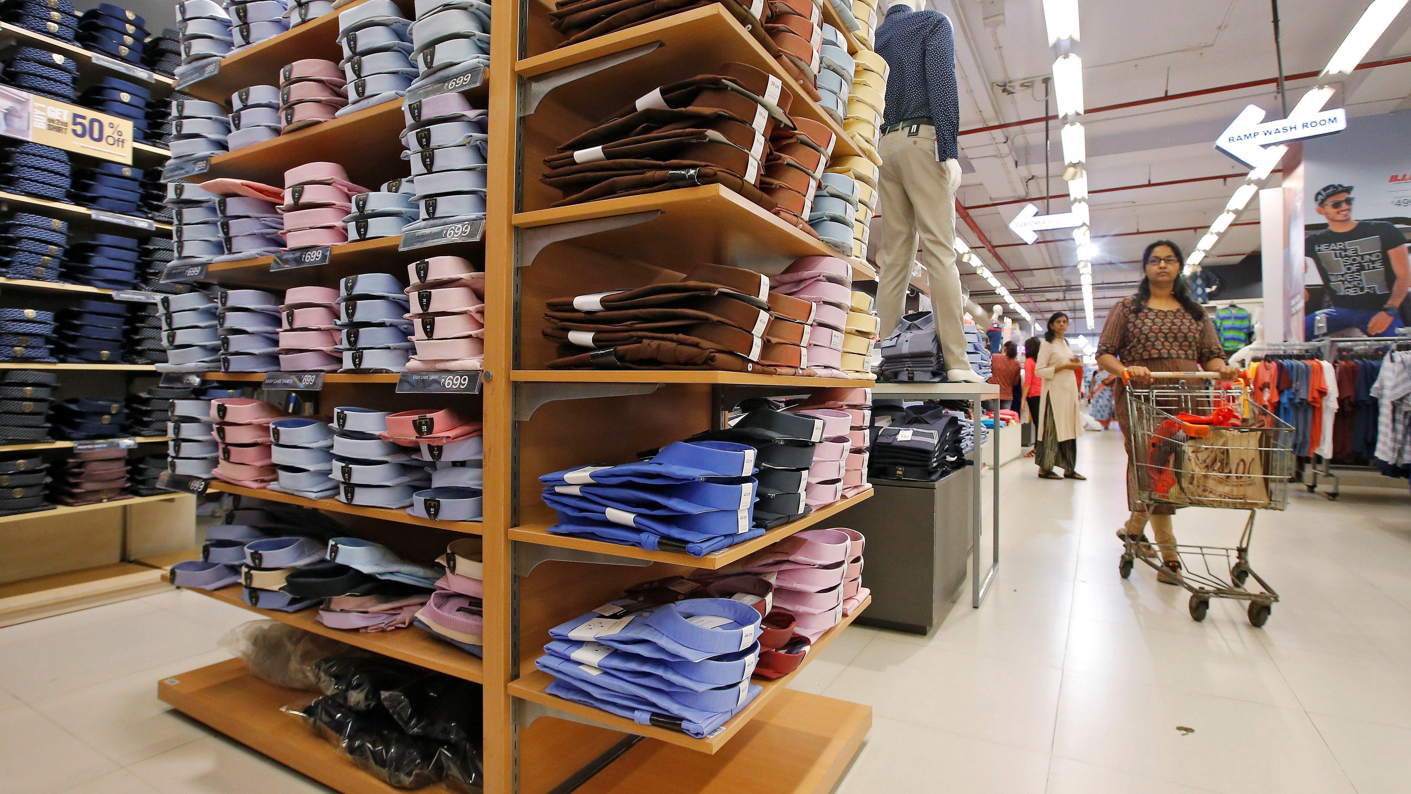 A customer walk inside a clothes store at a shopping mall in Kolkata