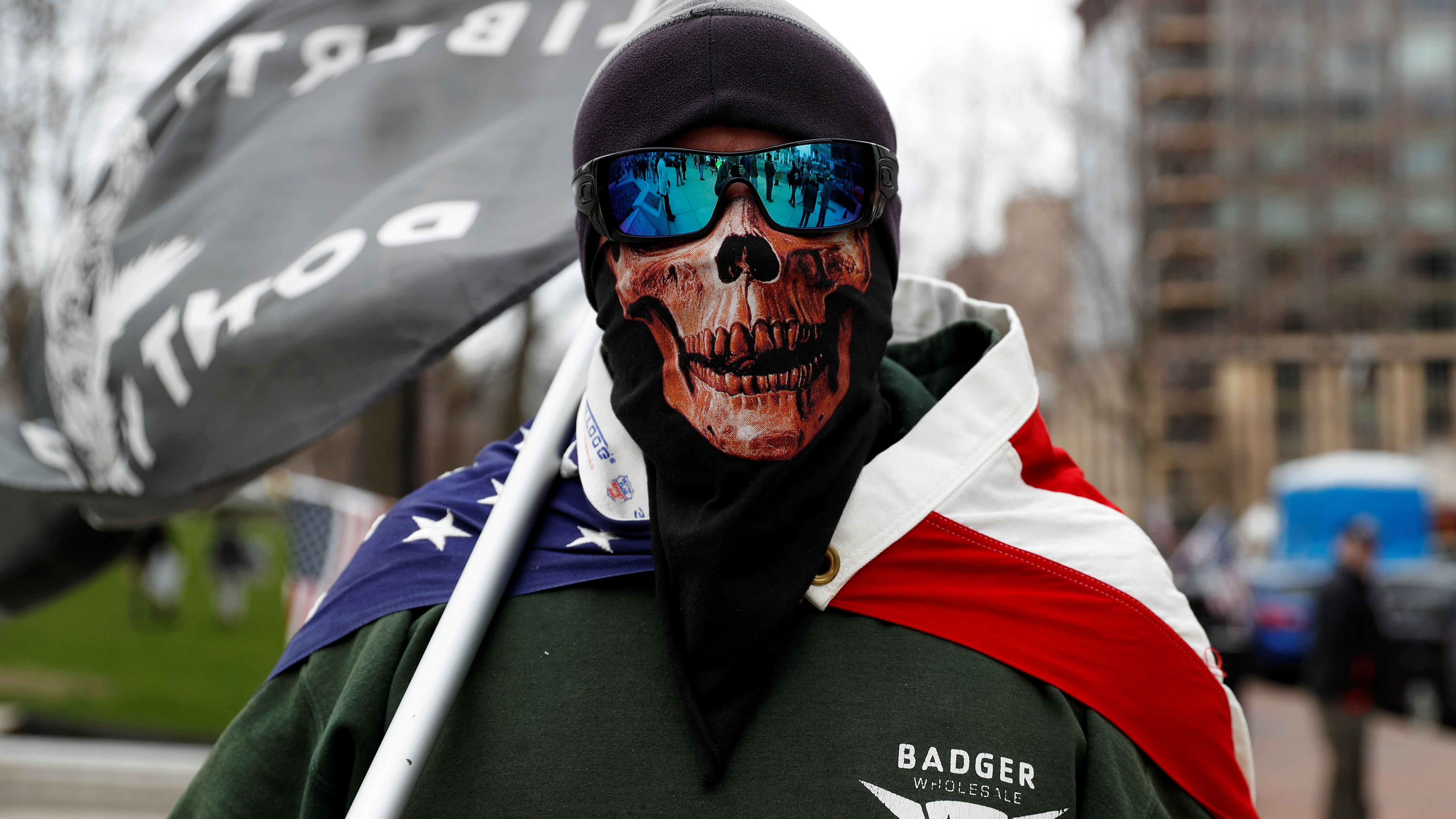 A man wearing a mask poses as demonstrators protest Covid stay at home orders in Wisconsin on April 24.