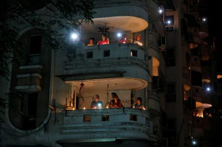 Prime minister Modi had asked Indians to stand in their balconies or their doorways, like these residents in Ahmedabad. Gujarat, did.