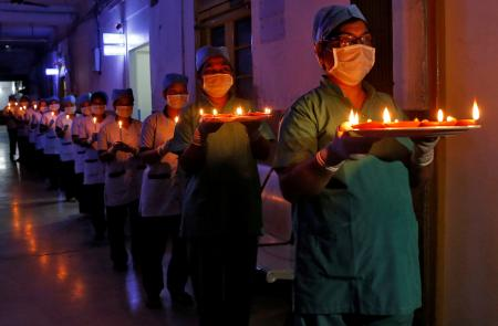 In Kolkata, health care staff also lit candles and diyas in solidarity.