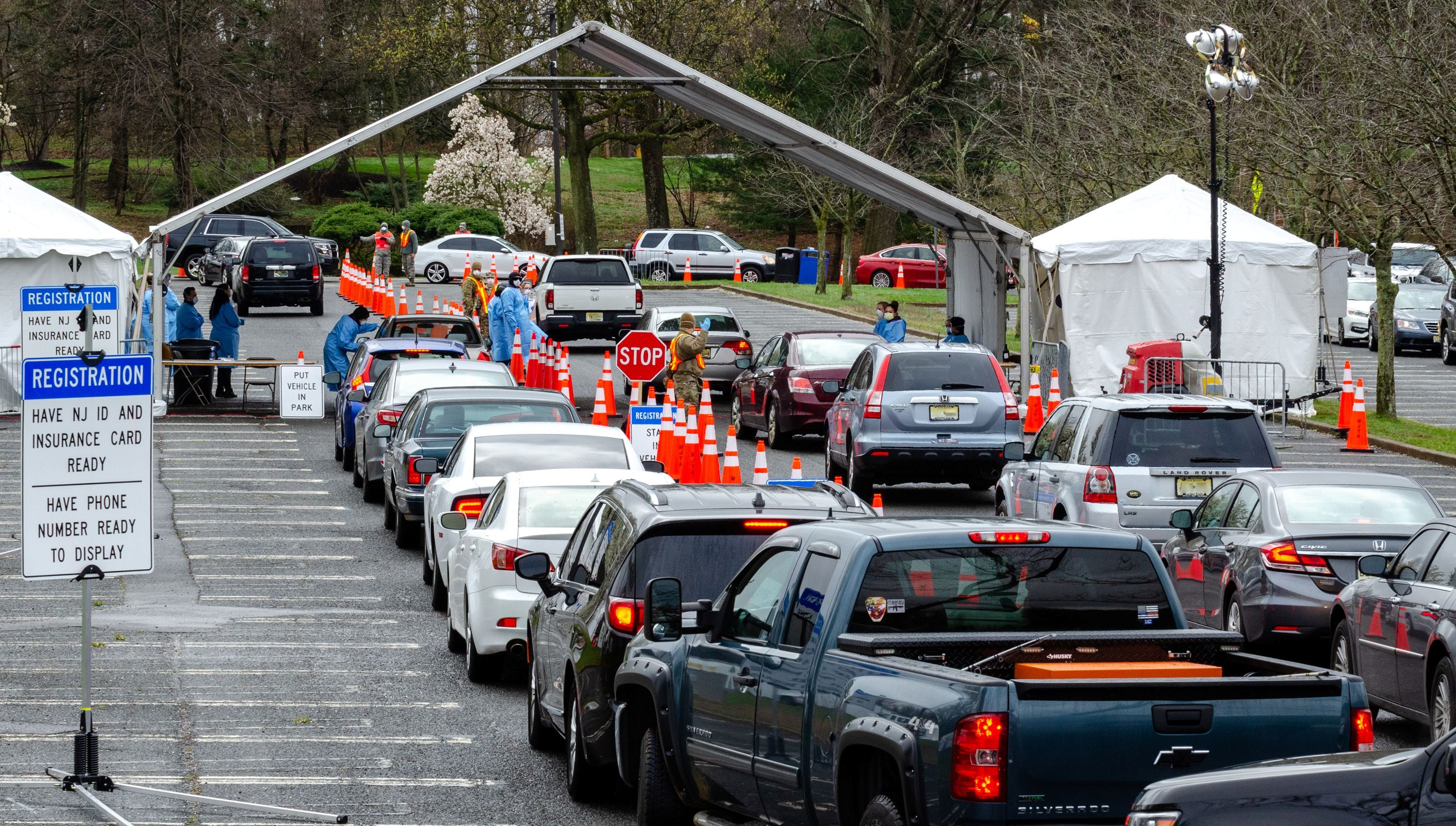 Cars form lines at a federally-supported drive-thru testing site in New Jersey