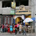 People line up outside a money transfer point at a neighborhood in Port-au-Prince, Haiti, February 16, 2019.