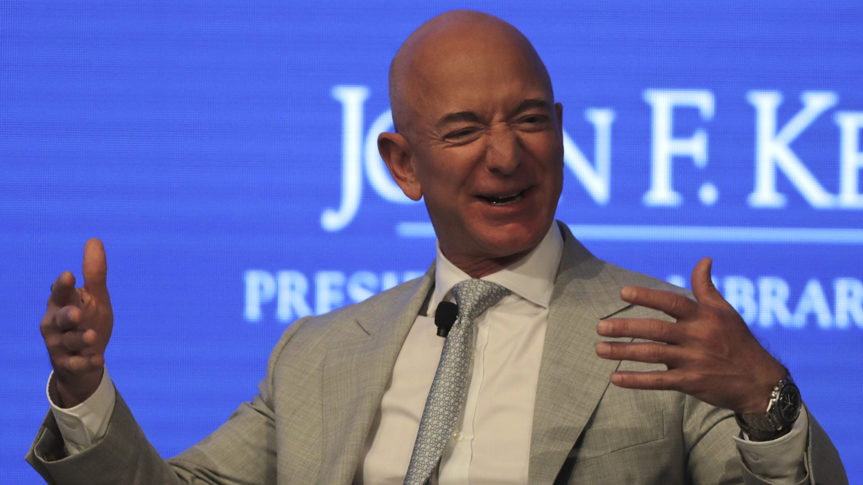 Jeff Bezos looking particularly happy at a conference