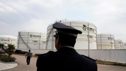 Oil tanks are seen at an oil warehouse at Yangshan port in Shanghai, China
