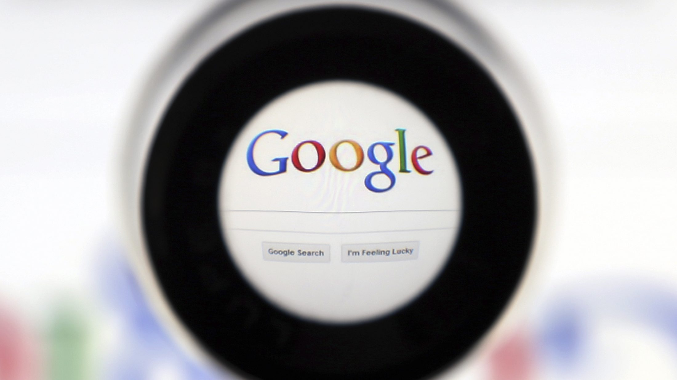 A Google search page is seen through a magnifying glass in this photo illustration taken in Brussels May 30, 2014. Google has taken the first steps to meet a European ruling that citizens can have objectionable links removed from Internet search results, a ruling that pleased privacy campaigners but raised fears that the right can be abused to hide negative information.
