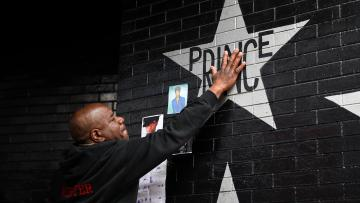 Donnie Straub of Minneapolis touches a star bearing Prince's name