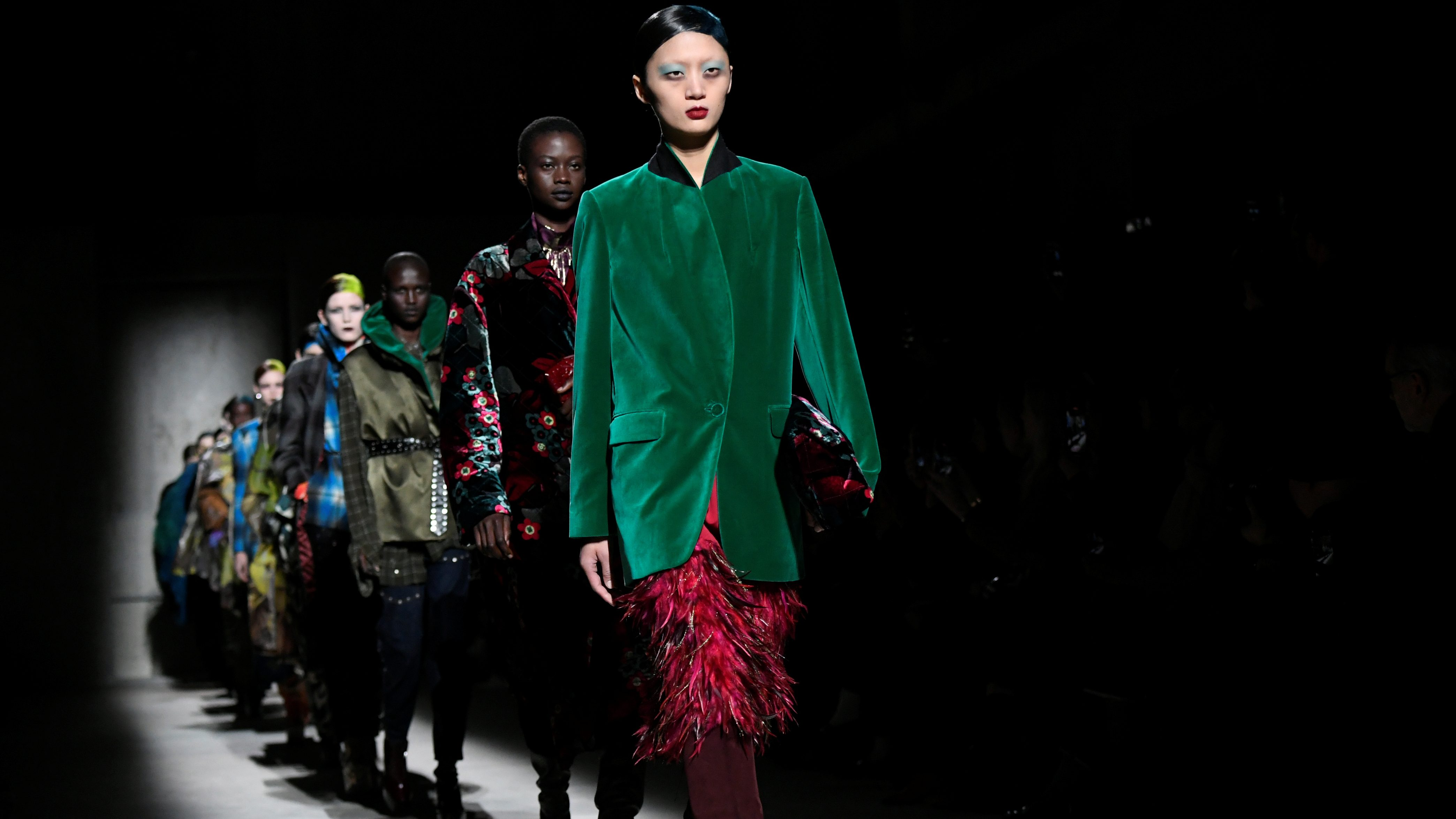 Models present creations by designer Dries Van Noten as part of his Fall/Winter 2020/21 women's ready-to-wear collection show during Paris Fashion Week