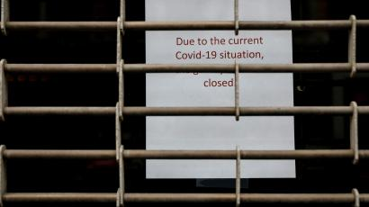 A closed sign is seen on a retail store, during the outbreak of the coronavirus disease (COVID-19), in New York City, U.S., April 29