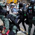 Anti-government demonstrators scuffle with riot police in Hong Kong on May 27.
