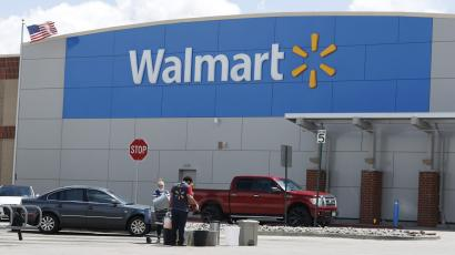 Workers sanitize items outside a Walmart