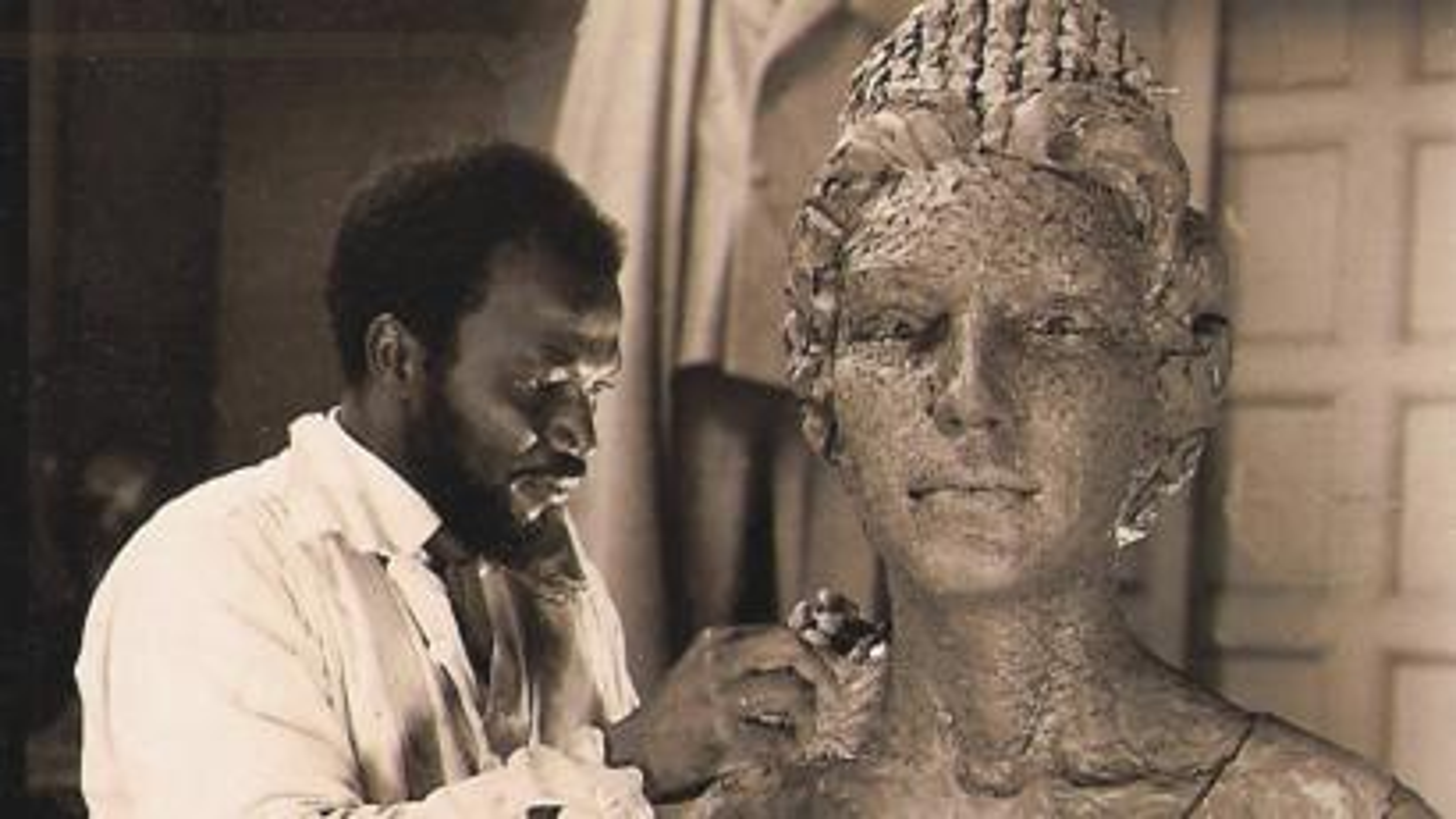 Archival picture of Ben Enwonwu in the studio of Sir William Reid- Dick, working on bronze portrait of Queen Elizabeth II. Courtesy of The Ben Enwonwu Foundation
