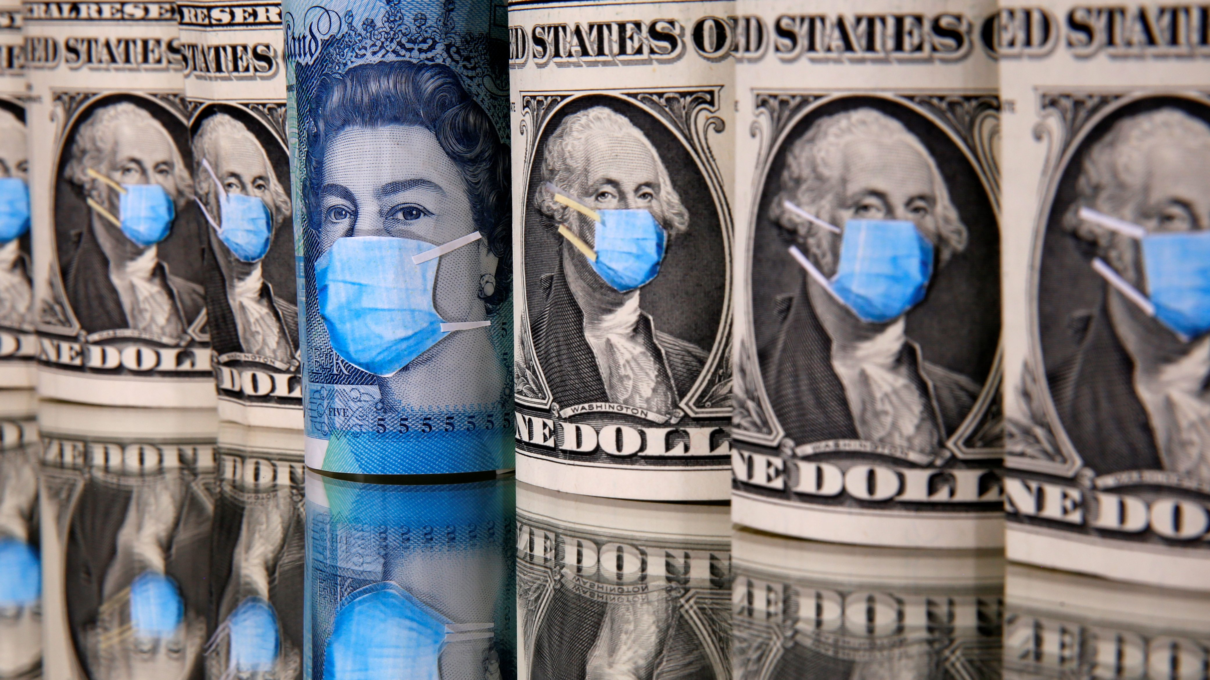 George Washington and Queen Elizabeth II are seen with printed medical masks on the one Dollar and Pound banknotes in this illustration.