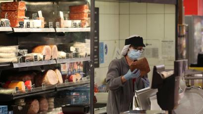 A worker wearing a protective mask is seen on duty at a Carrefour supermarket amid the coronavirus disease (COVID-19) outbreak in Brussels