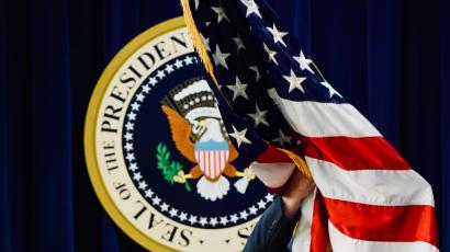 US flag and presidential seal.