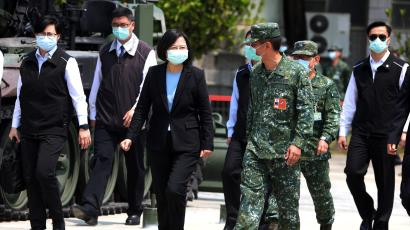 Taiwanese president Tsai Ing-Wen and soldiers wear face masks