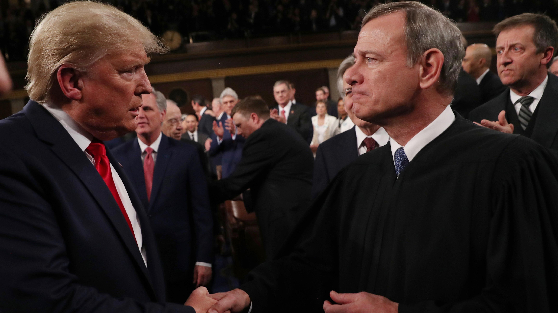 Trump and Roberts shake hands at the SOTU.