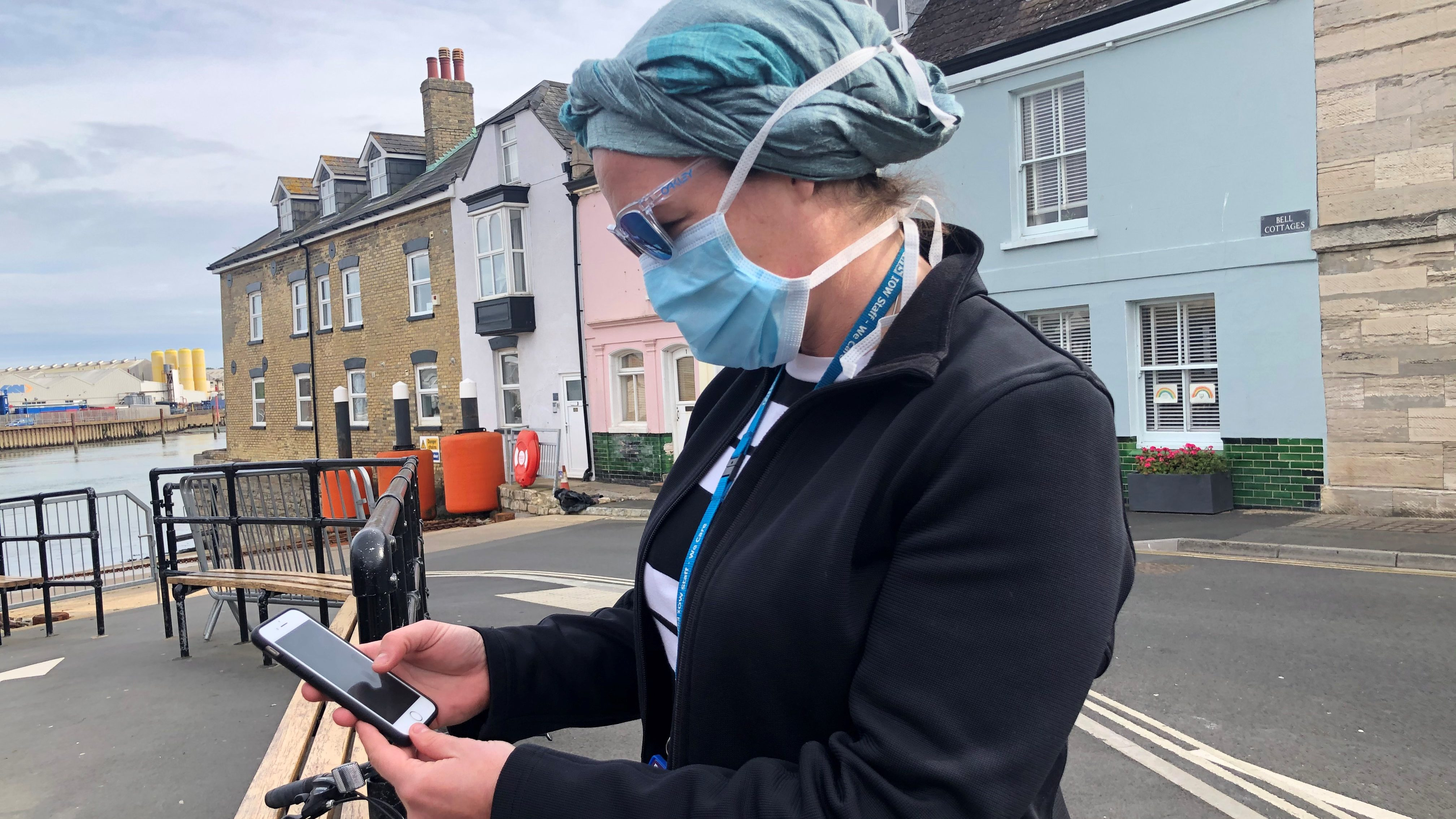 UK National Health Service employee looks at new NHS app to trace contacts with people potentially infected with the coronavirus disease (COVID-19) being trialled in the UK.