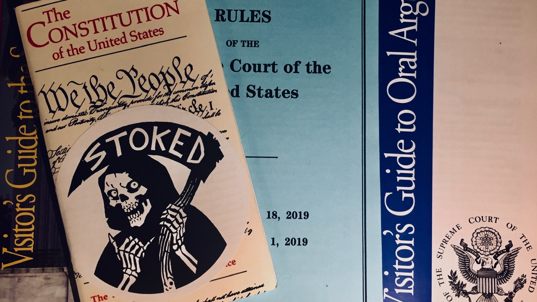 Constitution and SCOTUS guides with a sticker by cartoonist Becky Cloonan.