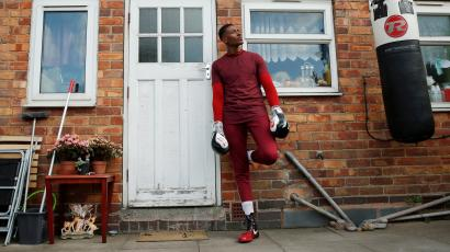 Boxer Shakan Peters poses during a training session in his mother's garden, following the outbreak of the coronavirus disease (COVID-19), UK