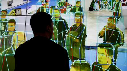 A man looks at a demonstration of facial recognition software.