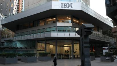 A man wearing a protective mask walks past an office building with IBM logo amidst the easing of the coronavirus disease (COVID-19) restrictions in the Central Business District of Sydney, Australia.