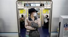 Passengers wearing protective face masks are seen amid the coronavirus disease (COVID-19) outbreak, at Tokyo Metro's newly-opened Toranomon Hills Station in Tokyo, Japan June 6, 2020. REUTERS/Issei Kato