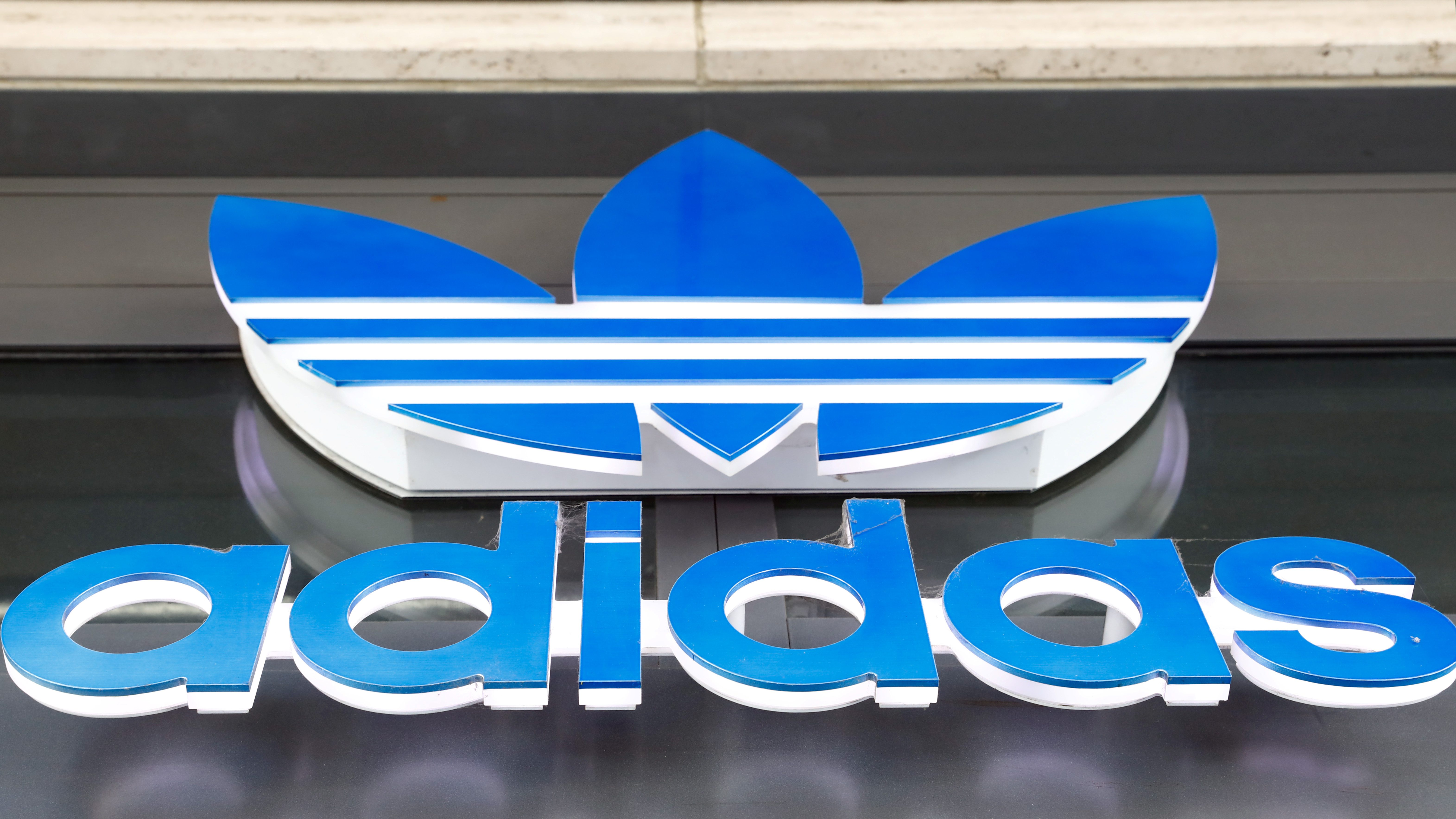 The logo above an Adidas shop in Berlin, Germany
