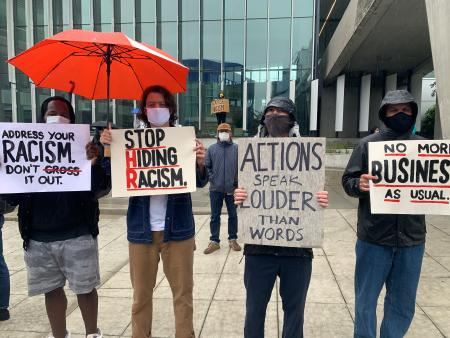 "Adidas employees protesting at its Portland headquarters with signs such as ""Stop hiding racism"""