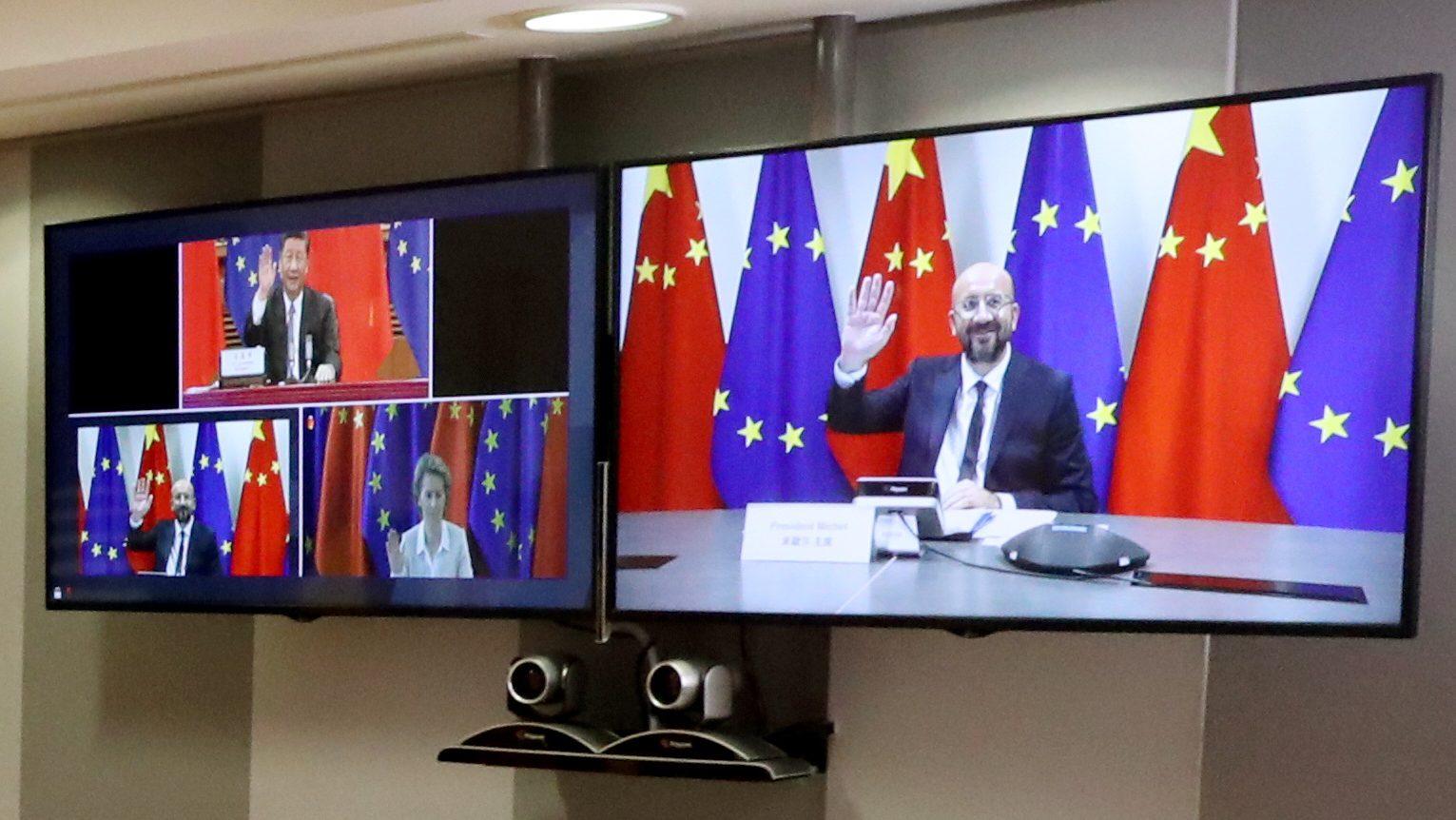 Screens show Charles Michel, Ursula Von der Leyen, and Xi Jinping
