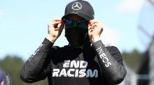 A man wearing an end racism sign.