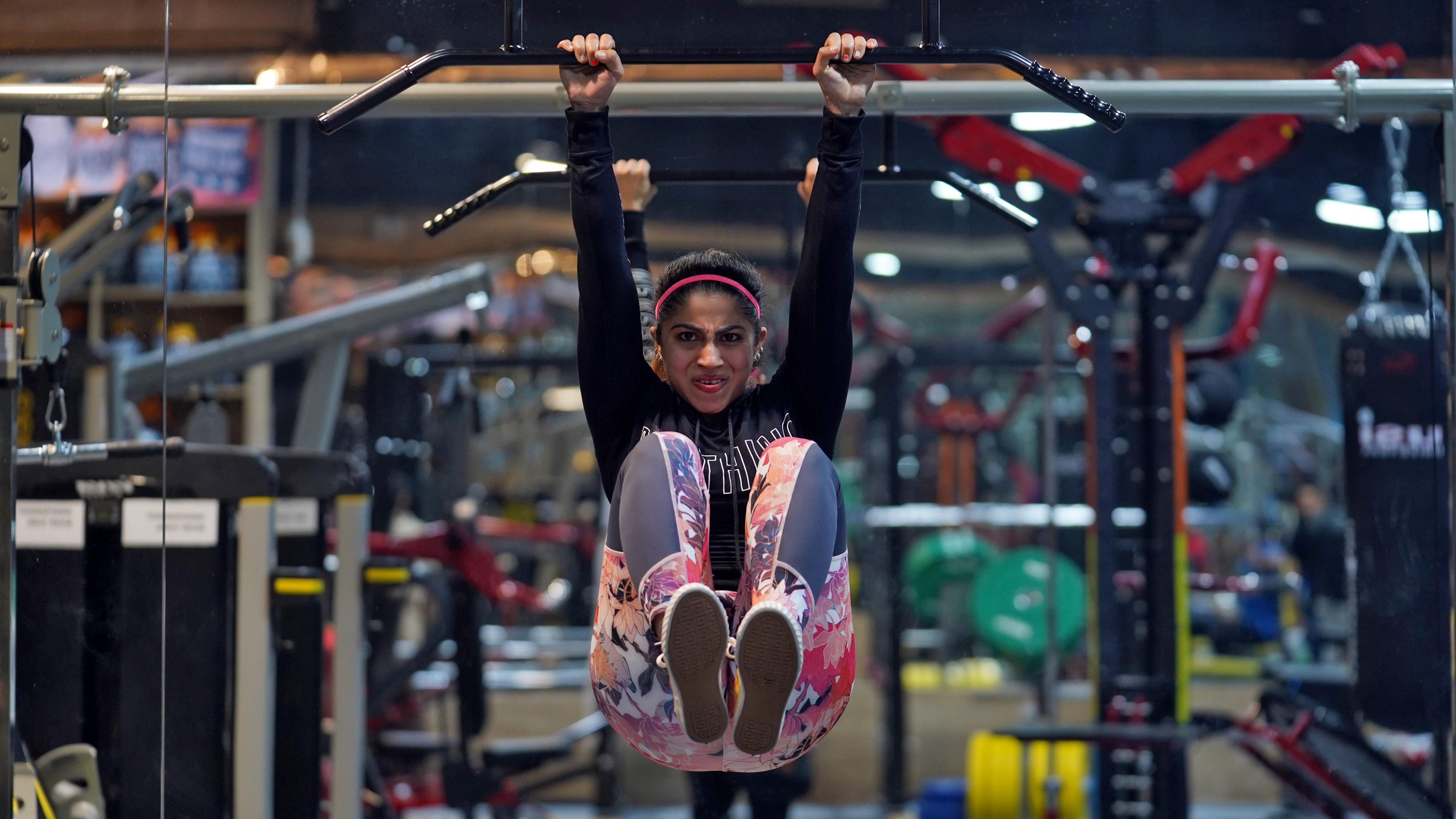 Fitness instructor Fatema Dhoondia exercises inside a gym in Mumbai