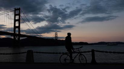 A cyclist is seen near the Golden Gate Bridge after lockdown orders were issued for the coronavirus pandemic on March 20.