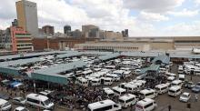 Passengers are seen at taxi rank just before Johannesburg locked down to stop the spread of coronavirus on March 25.